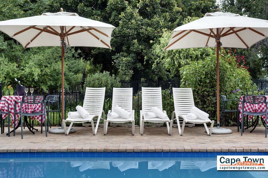 Pool loungers and poolside tables