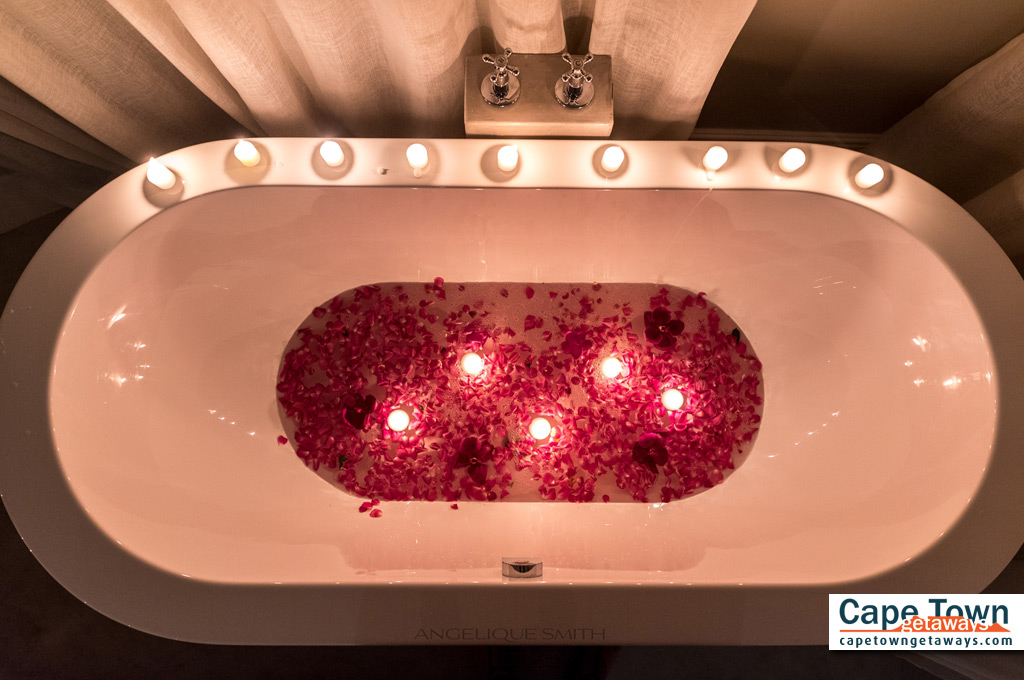 Blue Bay Relaxation Lodge Luxury Suite Bath with Candles and Rose Petals