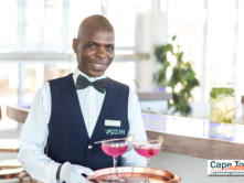 Friendly Blue Bay Relaxation Lodge Server with Cocktails