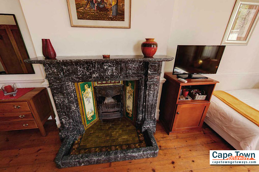 Carmichael Guesthouse Luxury Cape Town Accommodation luxury suite Victorian fireplace