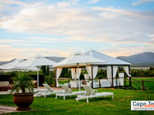 Beautiful, spacious area with beach chairs and tents in garden
