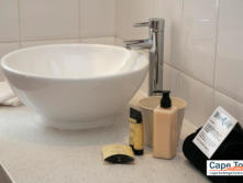 Basin with bathroom products