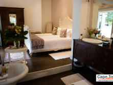 Bedroom with dressing table and basin