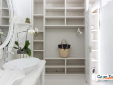 Organize your luggage neatly in this modern spacious cupboard