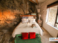 Comfortable king-size bed inside the main 'cave' with drawers and bed lamp