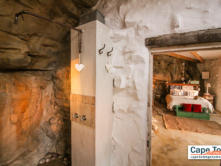 Rustic shower area inside the bathroom 'cave'