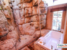 Spacious built-in en-suite bathtub inside the cave