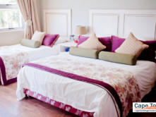 Queen-size and single bed in bedroom