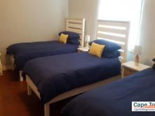 Bedroom with three single beds