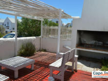 Self Cater patio area and outdoor barbecue